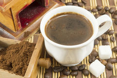 Cooffee time. Cup of coffee with sugar and coffee beans Royalty Free Stock Photos