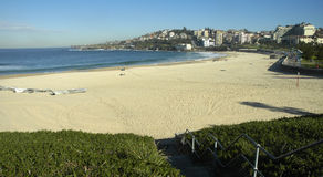 Coogee beach. Panorama of famous coogee beach in sydney, empty beach, small boats on left side Stock Image