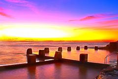 Coogee beach rock pool colourful sunrise. Royalty Free Stock Images