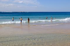 Coogee Beach, Sydney, Australia. Few swimmers at Coogee Beach, in Sydney`s Eastern Suburbs, on a fine mid-week Autumn day, with the yellow sand beach stirred up stock images