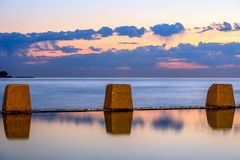 Coogee pool at dawn, NSW, Australia stock photography