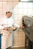 Cook. A cook working in commercial kitchen Royalty Free Stock Image