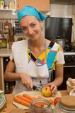 Cook. Girl is cooking in the kitchen Royalty Free Stock Image