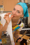 Cook. Girl is cooking in the kitchen Stock Image