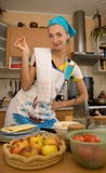 Cook. Girl is cooking in the kitchen Royalty Free Stock Photo