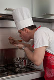 The Cook. Cook tasting a soup he is cooking stock photography