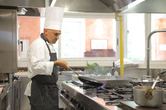 Cook. Preparing food in a restaurant kitchen stock image