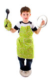 Cook. Five years old boy with cooking accessories, isolated Stock Photo