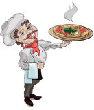 Cook. A cute smiling cook holds dish of pizza Royalty Free Stock Photography