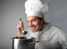 Cook. Portrait of cook tasting food Stock Photography