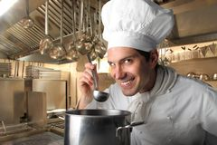 Cook. In a kitchen of a restaurant Stock Images