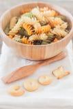 Cook alphabet biscuit with fusili pasta Stock Photos