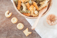 Cook alphabet biscuit with fusili pasta Stock Photography