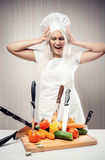 Cook. Angry and stressed out woman cook stock image