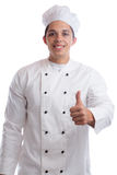 Cook apprentice trainee cooking thumbs up job young man isolated Royalty Free Stock Photography