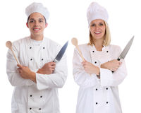 Cook apprentice trainee trainees cooks cooking with knife job yo Royalty Free Stock Photo