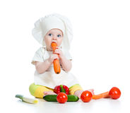 Cook baby eating healthy food Royalty Free Stock Images