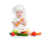Cook baby girl eating healthy food Stock Images