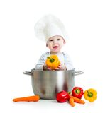 Cook baby inside big pan with healthy food. Cook baby sitting inside big pan with healthy food isolated on white Royalty Free Stock Image