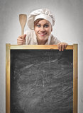 Cook Blackboard. Woman cook holding a blackboard Stock Photography