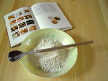 Cook-book. & flour on the table Royalty Free Stock Photography