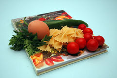 Cook - book. Cook-book with colourful vegetables on blue background Stock Photo