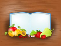 Cook book with fruit Royalty Free Stock Photo