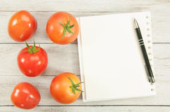 Cook Book Guide and tomato. Top view Cook Book Guide and tomato Royalty Free Stock Images