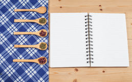 Cook book, kitchen tablecloth, spoon, fork Royalty Free Stock Photos