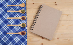 Cook book, kitchen tablecloth, spoon, fork Stock Photography
