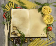Cook book with macaroni and spices Royalty Free Stock Photos