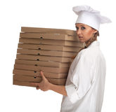 Cook with boxes of pizza Royalty Free Stock Image
