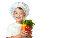 Cook boy Chef is holding fresh vegetables Stock Photo