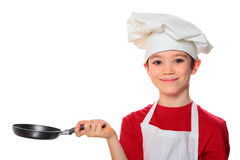 Cook boy on. Chef boy holding frying pan isolated on white background Stock Photography