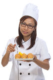 Cook bread woman show. Cook filed a bread that looks appetizing Stock Photo