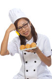 Cook bread woman show. Cook filed a bread that looks appetizing Royalty Free Stock Image