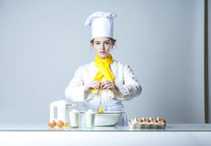 Cook breaking egg Royalty Free Stock Photography