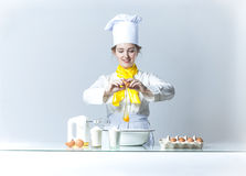 Cook breaking egg Royalty Free Stock Photos
