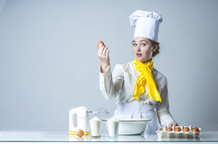 Cook breaking egg Royalty Free Stock Image
