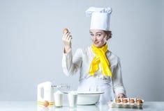 Cook breaking egg Stock Image