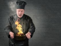 Cook burns the food. In the cooking pot royalty free stock photography