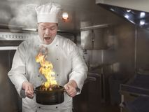 Cook burns the food. In the cooking pot royalty free stock image