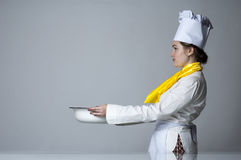 Cook carrying big bowl Royalty Free Stock Photo