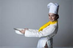Cook carrying big bowl Royalty Free Stock Photos