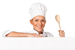 Cook, chef or baker holding wooden spoon. Isolated Royalty Free Stock Images