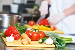 Cook chef hand preparing salad food Royalty Free Stock Photo