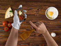 Cook chef hands with smartphone and ingredients for food on vint Stock Photo