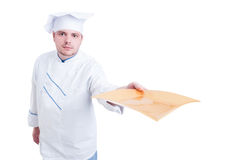 Cook or chef holding and serving an empty plate Royalty Free Stock Photos