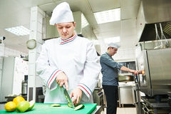 Cook chef at restaurant kitchen Royalty Free Stock Photography