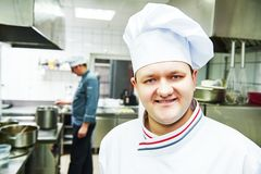 Cook chef at restaurant kitchen Stock Images